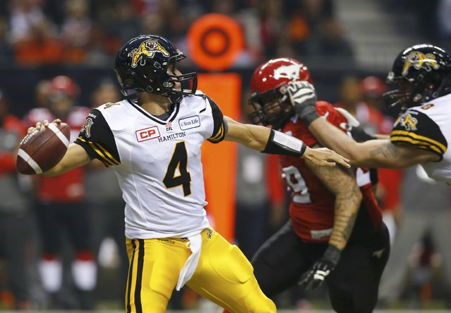 Hamilton Tiger Cats' quarterback Zach Collaros throws a pass against the Calgary Stampeders in the first half during the CFL's 102nd Grey Cup football championship in Vancouver, British Columbia, November 30, 2014. (Photo by Mark Blinch/Reuters)