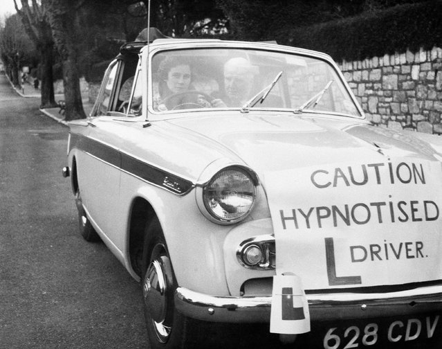It figures that motorists in Torquay, England, will give this car a wide berth. Not only is the driver, Sally Blythe, 17, hypnotized but she is learning to operate a car, Januaary 20, 1960. Riding with her is her father, hypnotist Henry Blythe, who claims to have aided 48 other learner drivers through hypnotism. (Photo by AP Photo)