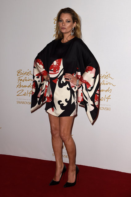 Kate Moss poses in the winners room at the British Fashion Awards at London Coliseum on December 1, 2014 in London, England. (Photo by Pascal Le Segretain/Getty Images)