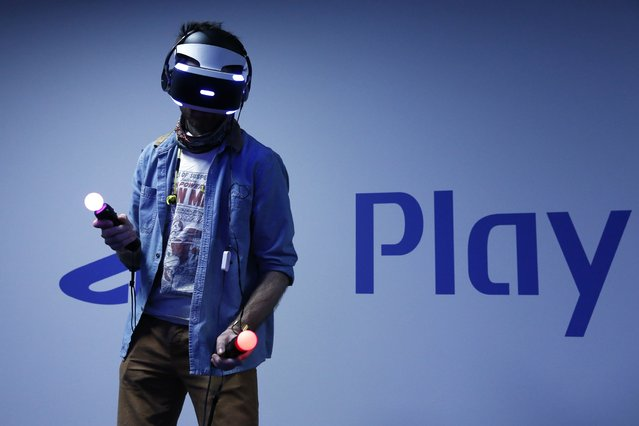 A visitor plays a game on a PlayStation VR at the Paris Games Week, a trade fair for video games in Paris, France, October 28, 2015. Paris Games week will run from October 28 to November 1, 2015. (Photo by Benoit Tessier/Reuters)