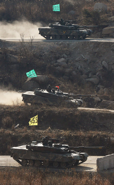 South Korean army K1 tanks participate in a military exercise at the Seungjin Fire Training Field in Pocheon, 65 kms northeast of Seoul, on March 27, 2013.  North Korea severed its military hotline with South Korea on March 27, breaking the last direct communication link between the two countries at a time of heightened military tensions. (Photo by AFP Photo/YONHAP)