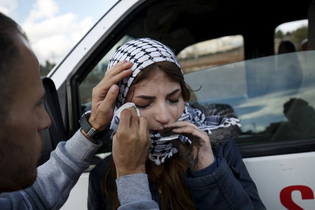 A medic wipes the eyes of a female Palestinian protester after she inhaled teargas fired by Israeli troops during clashes near the Jewish settlement of Bet El, near the West Bank city of Ramallah, October 29, 2015. Israeli security forces shot dead two Palestinian assailants in the occupied West Bank on Thursday, police and the army said, as a month-long spate of stabbing attacks showed no signs of abating. (Photo by Mohamad Torokman/Reuters)