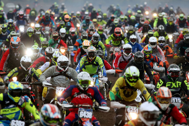 A view of the start of the 37th Gotland Grand National motocross race in Visby, Sweden on October 24, 2020. (Photo by Soren Andersson/TT News Agency via Reuters)