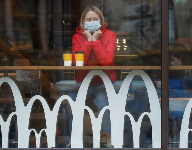 A woman wearing a protective face mask is seen inside a McDonald's restaurant amid the outbreak of the coronavirus disease (COVID-19) in Kyiv, Ukraine on October 22, 2020. (Photo by Valentyn Ogirenko/Reuters)