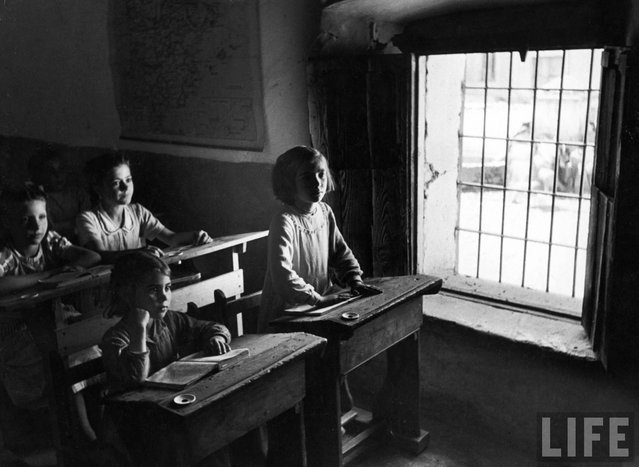 Girls are taught in separate classes from the boys. Four rooms and four lay teachers handle all pupils, as many as 300 in winter, between the ages of 6 and 14. (Photo by W. Eugene Smith/Time & Life Pictures)