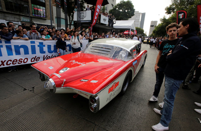 "A participant drives his 1956 GM Buick Centurion as he arrives in Mexico City to take part in the Carrera Panamericana (""Pan-American Road Race"") in Mexico October 15, 2016. (Photo by Henry Romero/Reuters)"
