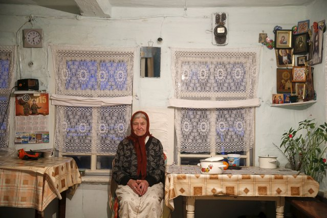 Vassa, 86, who suffers from hearing difficulties, poses in her house in the village of Kalach, Sverdlovsk region, Russia October 18, 2015. (Photo by Maxim Zmeyev/Reuters)