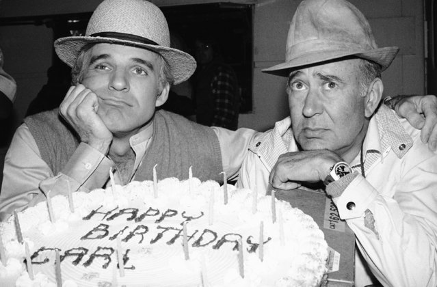 Comedian Steve Martin, left, and director-entertainer Carl Reiner, right, struggle pose by Reiners birthday cake, Tuesday, March 20, 1979, Los Angeles, Calif. Martin has begun filming his first motion picture The Jerk directed by Reiner recently in Los Angeles. Reiner was 56 Tuesday. (Photo by AP Photo/Eve)