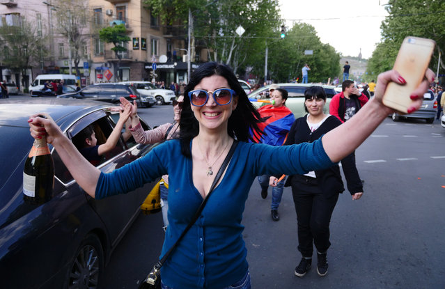 Yerevan residents celebrate Armenian Prime Minister's Serzh Sargsyan's resignation in Yerevan, Armenia, Monday, April 23, 2018. Sargsyan resigned unexpectedly on Monday, an apparent move to bring to an end massive anti-government protests. (Photo by Amos Chapple/RFE/RL)