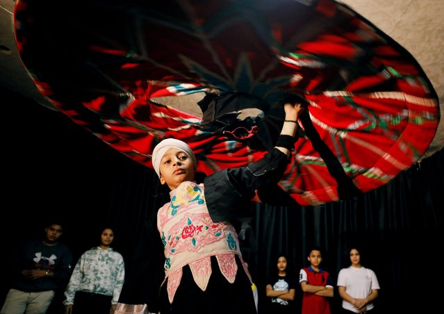 Abdelrahman Tarek, 11-year-old cancer patient practices traditional Tanoura dance to keep his spirits high as he battles the harsh illness at a small theatre in central Cairo, Egypt on November 21, 2020. (Photo by Mohamed Abd El Ghany/Reuters)