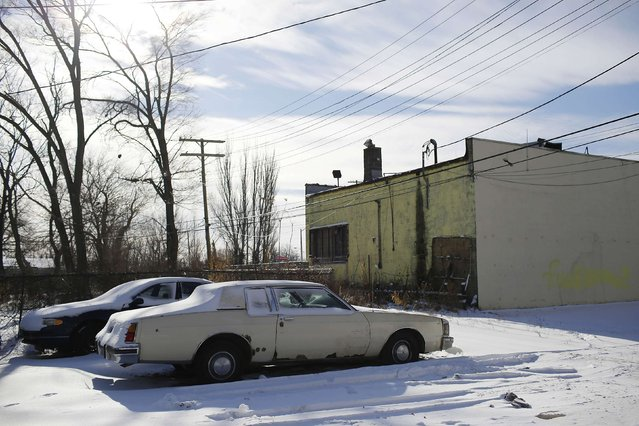 An Oldsmobile Delta 88 sits in the snow behind a building in Detroit, Michigan January 10, 2015. (Photo by Joshua Lott/Reuters)