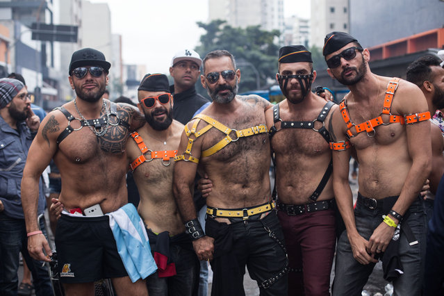 People attend the Gay Pride Parade on June 3, 2018 in Sao Paulo, Brazil. People gathered in Sao Paulo for the 22nd annual Gay Pride parade, which is considered one of the biggest ones in the world, (Photo by Rebeca Figueiredo/Getty Images)