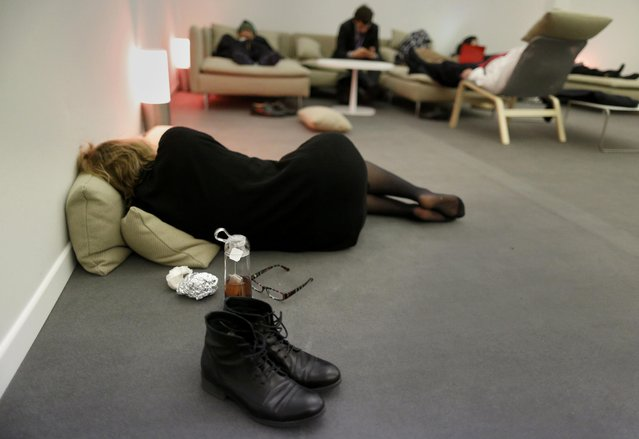 Observers take a rest during the World Climate Change Conference 2015 (COP21) in Le Bourget, near Paris, France, December 10, 2015. (Photo by Jacky Naegelen/Reuters)