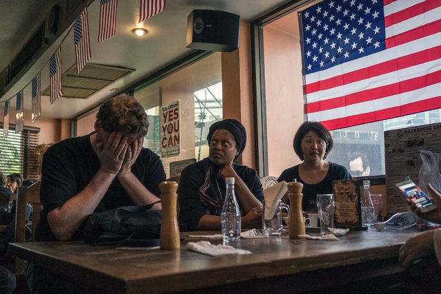 Americans living in Bangkok watch the numbers come in for the 2016 U.S. presidential elections on November 9, 2016. (Photo by Staton Winter/Polaris)