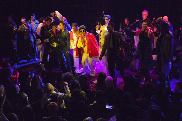 Contestants sing and dance together at the end of the 20th annual Seattle Invitationals, an amateur Elvis impersonator competition, in Seattle, Washington January 23, 2015. (Photo by David Ryder/Reuters)