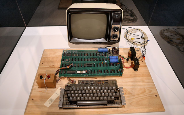 An Apple-1 computer, built in 1976, is displayed during the First Bytes: Iconic Technology From the Twentieth Century, an online auction featuring vintage tech products at the Computer History Museum in Mountain View, California. Christie's is auctioning off an original Apple-1 computer owned by Ted Perry as part of its First Bytes: Iconic Technology from the Twentieth Century, an online auction of vintage tech products. The online auction begins today and runs through July 9. The Apple-1 is expected to fetch between $300,000 and $500,000. (Photo by Justin Sullivan/Getty Images)