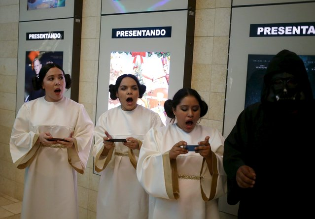 """Characters from Star Wars sing the soundtrack of the movie during an event held for the release of the film """"Star Wars: The Force Awakens"""" at a movie theater in Guatemala City, December 16, 2015. (Photo by Jorge Dan Lopez/Reuters)"""