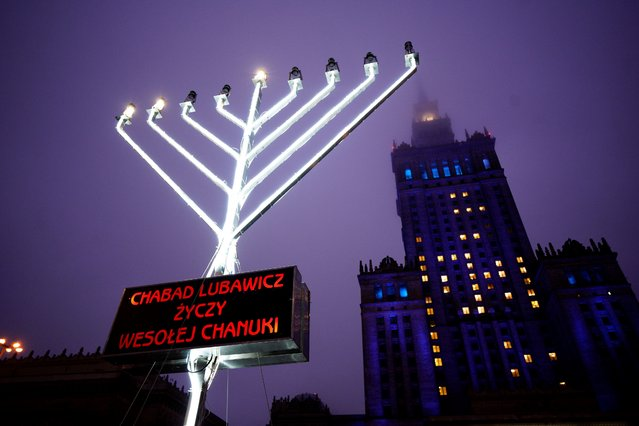 A large menorah is seen in front of the Palace of Culture and Sciences in Warsaw, Poland on December 11, 2020. From December 10 until 18 the Jewish festival of Hannukah will be celebrated. Jewish people used to make up nearly 30 percent of the city's populatin before the Second World War. (Photo by Jaap Arriens/NurPhoto via Getty Images)