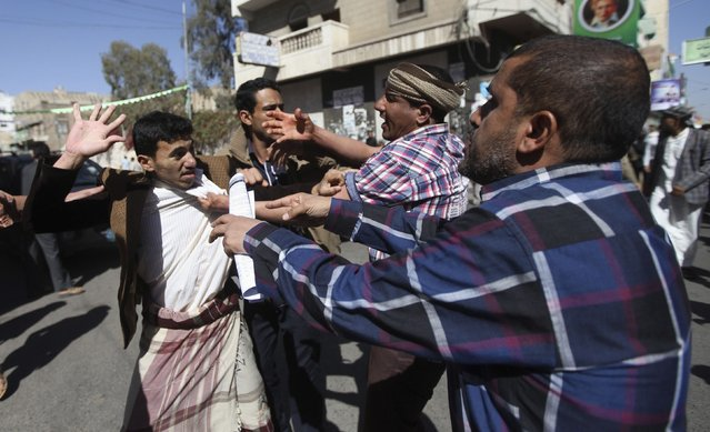 Supporters of the Houthi movement clash with anti-Houthi protesters during a rally in Sanaa January 24, 2015. Thousands of Yemenis took to the streets on Saturday in the biggest demonstration yet against the Houthi group that dominates Yemen, two days after President Abd-Rabbu Mansour Hadi's resignation left the country in political limbo. (Photo by Mohamed al-Sayaghi/Reuters)
