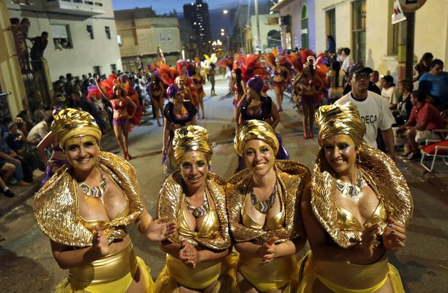 Members of a comparsa, a Uruguayan carnival group, dance during the Llamadas parade in Montevideo February 5, 2015. (Photo by Andres Stapff/Reuters)
