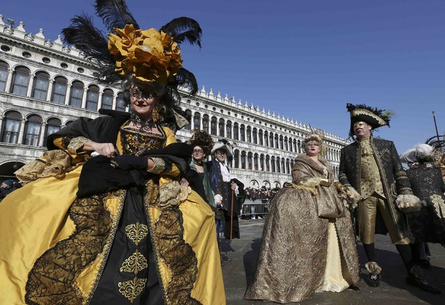 Masked revellers pose in Saint Mark square during carnival in Venice February 8, 2015. (Photo by Stefano Rellandini/Reuters)