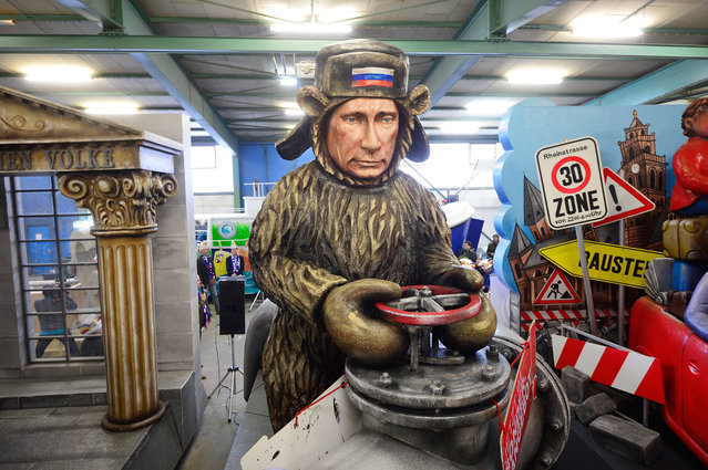 "A Carnival parade float satirizing Russia's President Putin under the motto ""Problem-Baer"" (Trouble-Bear) is seen on February 10, 2015 in Mainz, Germany. The Mainz Carnival parade will be held on Rose Monday, on February 16th, and is known for poking fun at politicians and celebrities. Rose Monday is among the high points of Carnival season, which is heavily celebrated throughout the Rhine region. (Photo by Thomas Lohnes/Getty Images)"