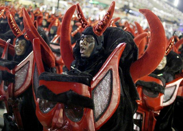 Revellers from the Grande Rio samba school participate in the annual carnival parade in Rio de Janeiro's Sambadrome, February 16, 2015. (Photo by Pilar Olivares/Reuters)