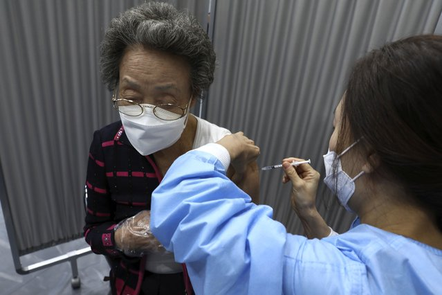 A South Korean elderly woman receives the first dose of the Pfizer-BioNTech COVID-19 vaccine at a vaccination center in Seoul, South Korea, Thursday, April 1, 2021. South Korea started its coronavirus vaccination for senior citizens over 75 years old. (Photo by Chung Sung-Jun/Pool Photo via AP Photo)