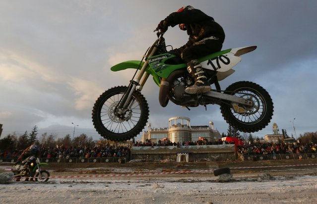 """Riders compete on the bank of the Yenisei River during the annual """"Winter Virage"""" motor sports festival dedicated to the Defender of the Fatherland Day in Russia's Siberian city of Krasnoyarsk, February 23, 2015. (Photo by Ilya Naymushin/Reuters)"""
