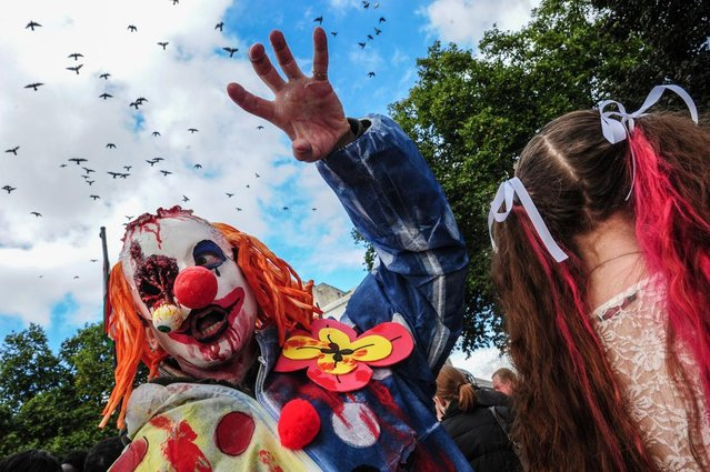 A participant dressed as a Zombie joins thousands of others as they invade the streets of London in a global event to raise money for a homeless charity. (Photo by Gail-Orenstein/Demotix/Corbis)
