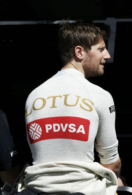 Lotus Formula One driver Romain Grosjean of France looks on during the first practice session of the Australian F1 Grand Prix at the Albert Park circuit in Melbourne March 13, 2015. REUTERS/Brandon Malone
