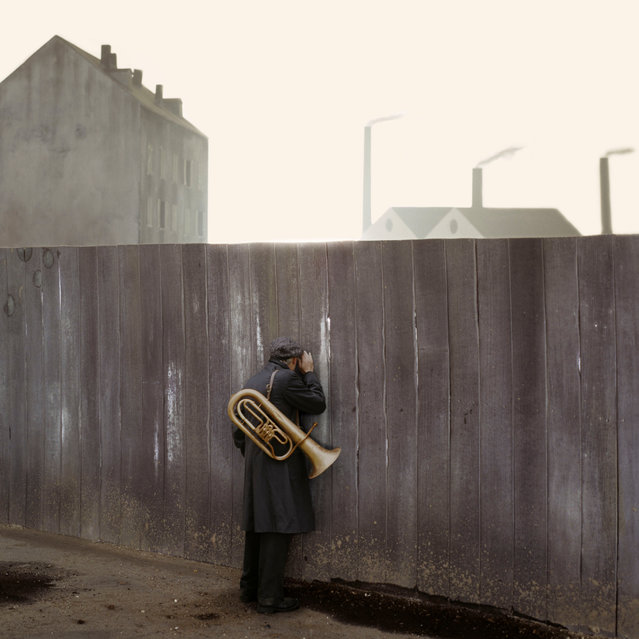 """Behind the Walls #06, 2011 by Paolo Ventura. """"Between Christmas and New Year's Eve, travelling musicians passed through the streets of the city where I lived as a child in the mid 70s. We ran to the balcony and threw coins to them. I remember one of these musicians had an old black hat with wide flaps. When we gave him coins he used to bow, take off his hat and make a beautiful movement with his arm while winking at my grandmother"""". (Photo by Paolo Ventura/Courtesy Aperture)"""