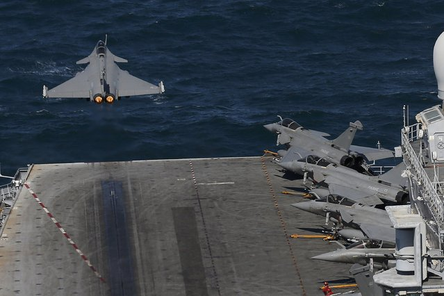 A Rafale fighter jet is catapulted from the flight deck as it leaves on a mission aboard France's Charles de Gaulle Aircraft carrier in the Gulf, January 28, 2016. (Photo by Philippe Wojazer/Reuters)