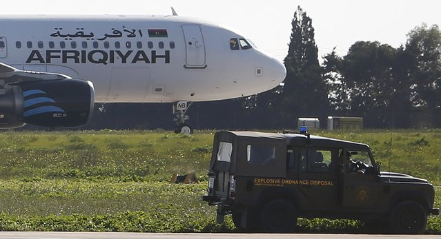 A Maltese military vehicle stands near a  hijacked Libyan Afriqiyah Airways Airbus A320 on the runway at Malta Airport, December 23, 2016. (Photo by Darrin Zammit-Lupi/Reuters)