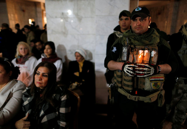 Iraqi Christians attend a mass on Christmas eve at the Mar Shemoni church in the town of Bartella east of Mosul, December 24, 2016. (Photo by Ammar Awad/Reuters)