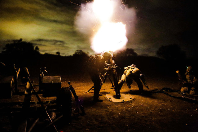 U.S. Army Rangers assigned to 2nd Battalion, 75th Ranger Regiment, fire a 120 mm mortar during a tactical training exercise on Camp Roberts, Calif., January 30, 2014. Rangers constantly train to maintain the highest level of tactical proficiency. (Photo by Pfc. Nathaniel Newkirk/U.S. Army)
