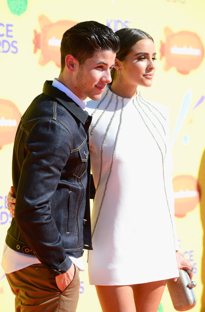 Recording artist Nick Jonas and actress Olivia Culpo attend Nickelodeon's 28th annual Kids' Choice Awards held at The Forum on March 28, 2015, in Inglewood, California. (Photo by Frazer Harrison/Getty Images)