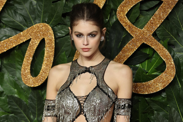 US model Cindy Crawford's daughter, US model Kaia Jordan Gerber poses on the red carpet upon arrival to attend the British Fashion Awards 2018 in London on December 10, 2018. The Fashion Awards are an annual celebration of creativity and innovation will shine a spotlight on exceptional individuals and influential businesses that have made significant contributions to the global fashion industry over the past twelve months. (Photo by Daniel Leal-Olivas/AFP Photo)