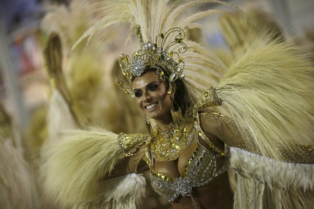 A reveller of the Vila Isabel samba school performs during the carnival parade at the Sambadrome in Rio de Janeiro February 8, 2016. (Photo by Ricardo Moraes/Reuters)