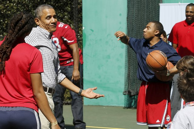 U.S. President Barack Obama jokes around after hitting a basket while playing basketball, an exercise activity during the annual Easter Egg Roll at the White House in Washington April 6, 2015. (Photo by Jonathan Ernst/Reuters)