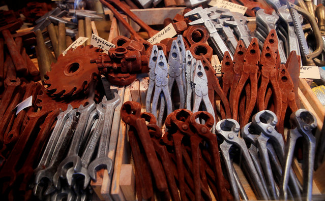Tools made from chocolate are offered at a stall on the Christmas market in front of Einsiedeln Abbey in Einsiedeln, Switzerland December 3, 2017. (Photo by Arnd Wiegmann/Reuters)