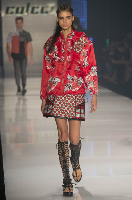 A model wears a creation from the Colcci Summer collection during the Sao Paulo Fashion Week in Sao Paulo, Brazil, Wednesday, April 15, 2015. (Photo by Andre Penner/AP Photo)