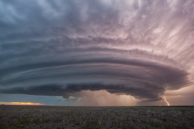 A super cell thunderstorm illuminates the sky, which was formed at about 2pm in the afternoon and was still raging at 10pm at night, in Sanford, Kansas. (Photo by Wiktor Skupinski/Barcroft Media)
