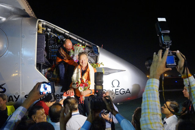 Pilot Bertrand Piccard (L) and pilot Andre Boschberg are welcomed after landing Solar Impulse 2, the world's first airplane flying on solar energy, in Ahmedabad, India, March 10, 2015. (Photo by Jean Revillard/Reuters)