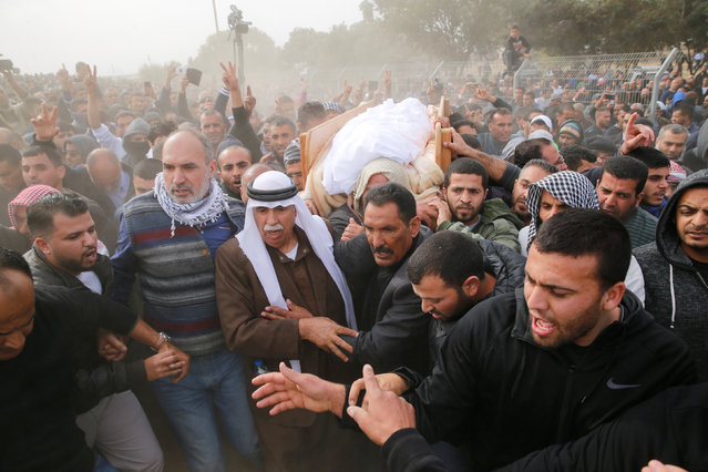 Friends and relatives carry the body of Arab Israeli Ya'akub Abu Al-Qi'an during his funeral in the Bedouin village of Umm al-Hiran, southern Israel January 24, 2017. (Photo by Ammar Awad/Reuters)