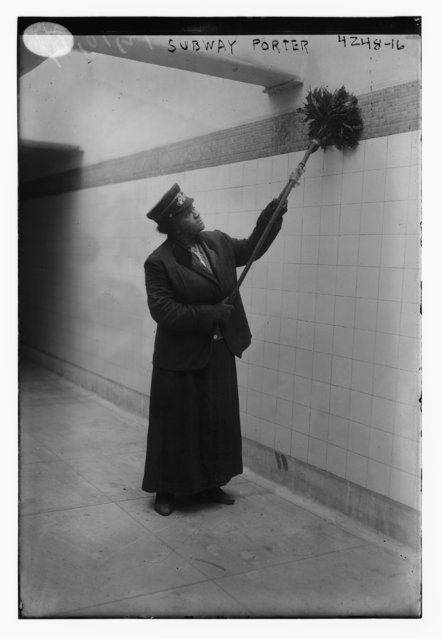 An African American woman dusts as she works as a porter at a subway station in New York City, United States, circa 1917, in this Library of Congress handout photo. (Photo by Reuters/Bain Collection/Library of Congress)