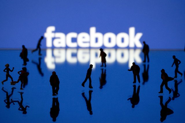 Picture taken on May 12, 2012 in Paris shows an illustration made with figurines set up in front of Facebook's homepage. Facebook, already assured of becoming one of the most valuable US firms when it goes public later this month, now must convince investors in the next two weeks that it is worth all the hype. (Photo by Joel Saget/AFP Photo)