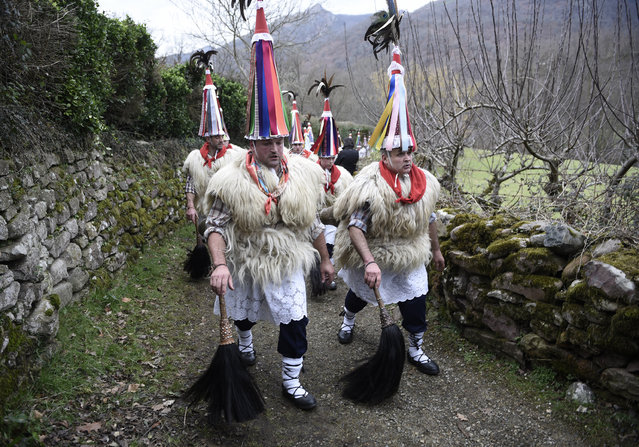 """Bellringers, known as """"Joaldunak"""" in Basque language march with big cowbells hanging on their back during the ancient carnival of Ituren, in the northern Spanish Navarra province on January 30, 2017. (Photo by Ander Gillenea/AFP Photo)"""