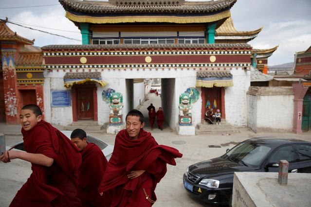 Buddhist monks leave Rongwo Monastery in the largely ethnic Tibetan town of Rebkong, Qinghai province, China on March 9, 2019. (Photo by Thomas Peter/Reuters)