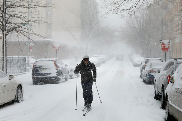 A man uses cross-country skis to travel down a street during a heavy snow storm in the Brooklyn borough of New York, U.S. February 9, 2017. (Photo by Lucas Jackson/Reuters)